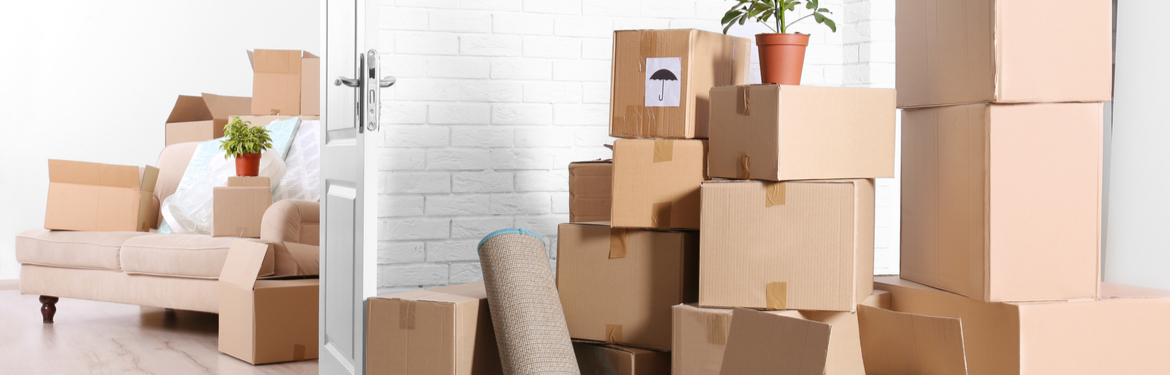 A pile of boxes in an empty room